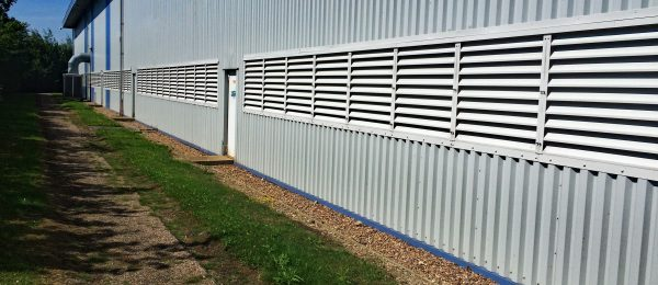 White Painted Aluminium Fixed Blade Natural Ventilation Louvres installed into a factory building in Yorkshire