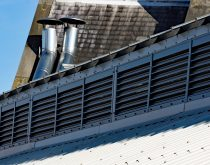 A run of grey painted A series natural ventilation weather louvres at Hull Trinity Market