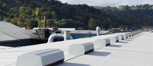 A line of Mackridge natural ridge ventilators in-situ on a roof in Todmorden