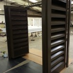 A view of an acoustically louvred double plantroom door painted brown
