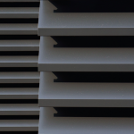 A close up view of 2 Maximair extruded natural ventilation louvres painted grey