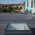 A single natural ventilation louvre rooflight turret painted grey and installed into a school in London