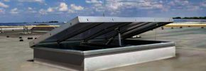 A Firemac 2000 single flap smoke ventilating AOV system installed into a factory roof